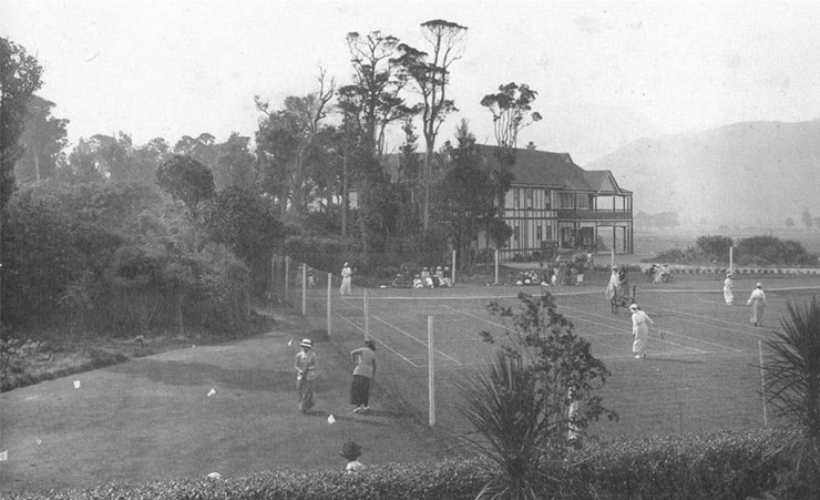 The tennis courts with the clubhouse in the background, c.1920s.(RWGC)